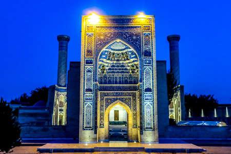 Samarkand Gur-e Amir Complex Mausoleum Main Gate Entrance View Iwan Muqarna Honeycomb Stalactite Vaulting at Night 에디토리얼
