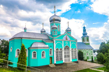 Mukachevo Saint Nicholas Monastery Chapel Church Side View with Main Cathedral at Background 版權商用圖片