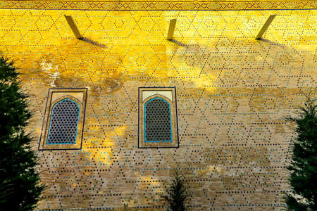 Samarkand Registon Square Ensemble Tilya Kori Gilded Madrasa Facade View at Sunset Stock Photo