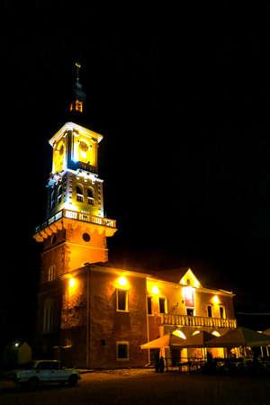 Kamianets Podilskyi Ratusha City Hall Illuminated with Lights at Night Side View Stock Photo