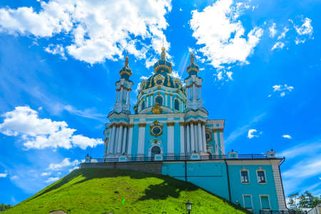 Kiev Old Town Saint Andrew's Church on Hill with Back View Blue Sky White Clouds Background Фото со стока