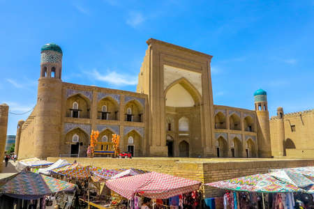 Khiva Old Town Kutlug Murad Inak Madrasa Iwan Main Entrance Gate Viewpoint with Souvenir Sellers