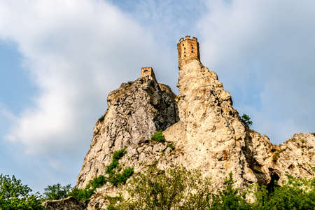 Devin Castle Exterior View of Two Watchtowers on a Rocky Hill with Picturesque Breathtaking Blue Cloudy Sky at Background
