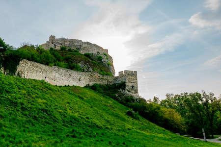 Devin Castle Low Angle View of Exterior Fortified Walls on a Hill with Picturesque Blue Cloudy Sky Background Stok Fotoğraf