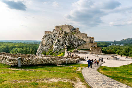 Devin Castle Fortified Walls Rocks with Walking Tourists at the Courtyard and Breathtaking Picturesque Landscape View