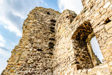 Devin Castle Low Angle View of Ruined Fortified Wall with Window and Blue Cloudy Sky at Background Stok Fotoğraf