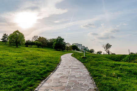 Devin Castle Main Paved Stone Road Leading to the Ruined Fortified Walled with Cloudy Sky Background Stok Fotoğraf