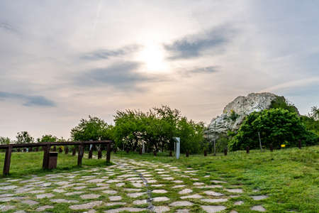 Devin Castle Paved Road Leading the Main Viewpoint with Breathtaking Picturesque Cloudy Sky and Rock at Background 版權商用圖片