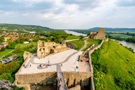 Devin Castle High Angle View Fortified Walls Rocks with Walking Tourists at the Courtyard and Breathtaking Picturesque Landscape Sight Stok Fotoğraf