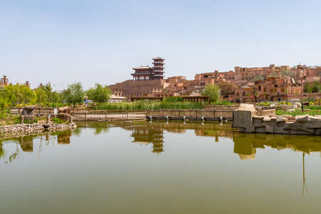 Kashgar Renovated Old City View of Park Lake with Wooden Terrace and Chinese Architectural Pagoda Pavilion at Background on a Sunny Blue Sky Day