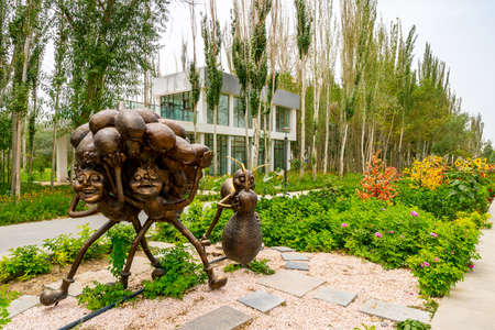 Hotan Picturesque Kunlun Lake Park View of Cartoon Ants Carrying Grapes on their Heads Statue on a Cloudy Blue Sky Day