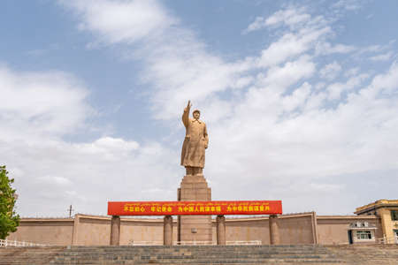 Kashgar Giant Statue of Chairman Mao Zedong at People's Park Square on a Sunny Blue Sky Day Stock Photo