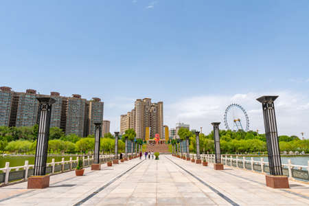 Kashgar Donghu Park View with Walking People and Residential Skyscraper Buildings at Background Sunny Blue Sky Day