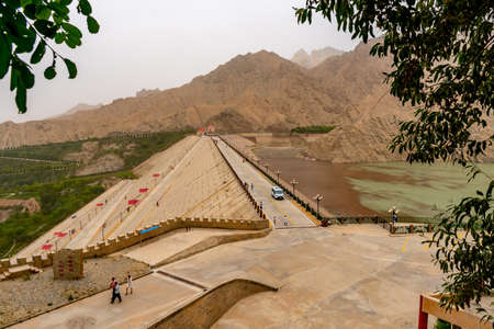 Hotan Wuluwati Hydroelectric Power Generation Dam High Angle View of the Bridge with Cars and Visitors on a Foggy Day