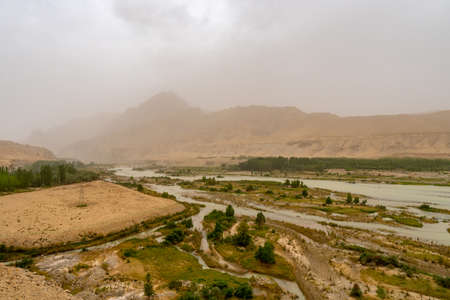 Hotan Wuluwati Hydroelectric Power Generation Dam View of the Karakash Black jade River on a Foggy Day 版權商用圖片