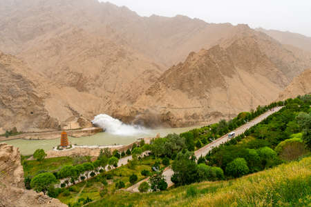 Hotan Wuluwati Hydroelectric Power Generation Dam High Angle View of the Released River Stream and Pagoda on a Foggy Day
