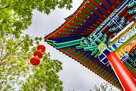 Urumqi Renmin Gongyuan People's Park Breathtaking Lake Pavilion Ceiling with Hanging Lanterns on a Sunny Blue Sky Day 스톡 콘텐츠