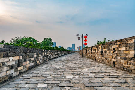 Nanjing Chengqiang Ming City Wall Leading Lines During of the Wall Road with Chinese Lanterns Afternoon Sunset Фото со стока