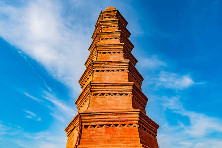 Urumqi Hong Shan Red Mountain Park with Seven Level Stupa Pagoda Low Angle View on a Sunny Blue Sky Day Редакционное