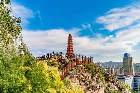 Urumqi Hong Shan Red Mountain Park with Seven Level Stupa Pagoda and Visitors on a Sunny Blue Sky Day