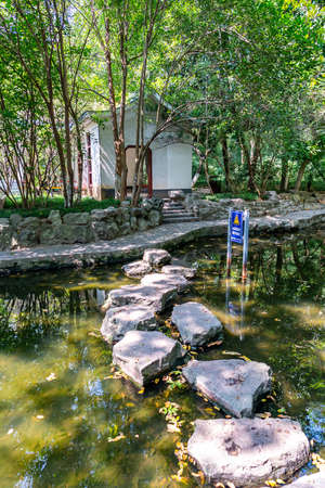 Wuhu Anhui Zheshan Gongyuan Park Picturesque Stone Path at Little Pond for Walking to the Opposite Side