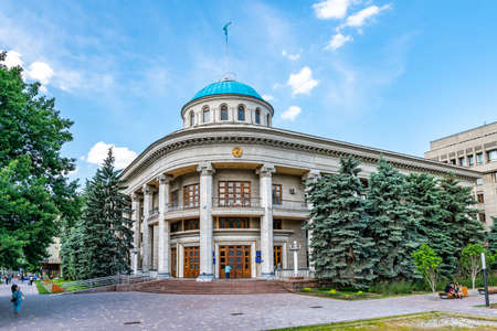 Almaty Akimat Administration Building for Almatinsky Region with Waving Kazakhstan Flag on the Top of the Roof on a Sunny Blue Sky Day