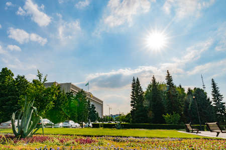 Almaty City Mayor Office Picturesque Breathtaking Park View with Sun Rays on a Sunny Blue Sky Day