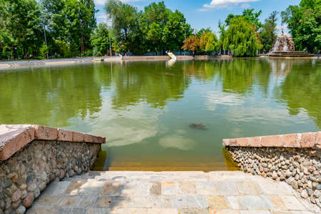 Almaty Central Park Picturesque Breathtaking View of a Lake with an Artificial Waterfall on a Sunny Blue Sky Day