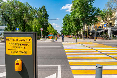 Almaty Panfilov Walking Street with Crosswalk and Turned on Red Traffic Lights on a Sunny Blue Sky Day