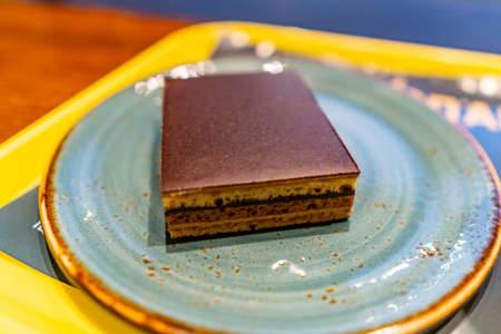 Tasty Mouthwatering Appetizing Sugary Sweet Chocolate Cake Served on a Turquoise Colored Plate