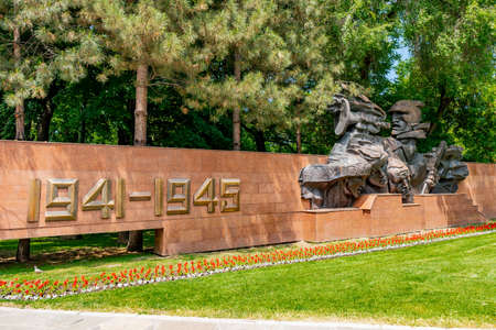Almaty Park of 28 Panfilov Guardsmen World War II Monument with a Soviet Soldier Head Sculpture on a Sunny Blue Sky Day Redakční
