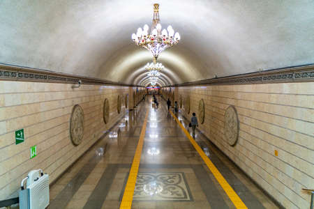 Almaty Metro Auezov Theater Subway Station Corridor with Walking People Leading to the Trains