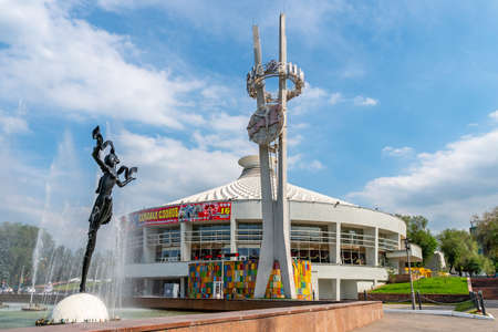 Almaty Kazakh State Circus Frontal View of a Stele and Dancing Woman Statue at a Fountain on a Sunny Blue Sky Day