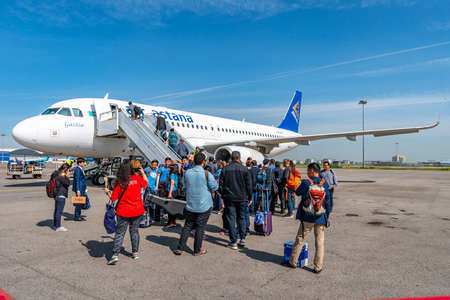 At Almaty International Airport Passengers are Waiting Outside for Boarding the Air Astana Aircraft Plane