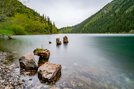 Saty Kolsai Lakes Breathtaking Picturesque Panoramic Landscape Low Angle Long Exposure View on a Cloudy Blue Sky Day
