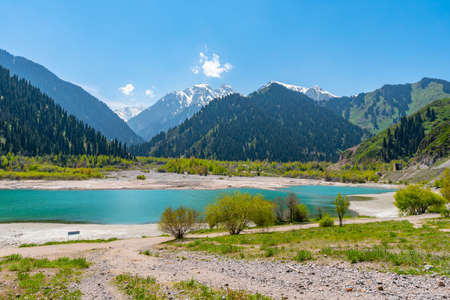 Esik Lake Issyk Picturesque Breathtaking View with Snow Capped Mountains on a Sunny Blue Sky Day Stok Fotoğraf