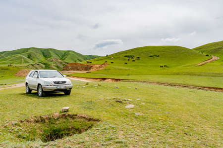 Saty Kolsai Lakes Breathtaking Picturesque Panoramic Landscape View of Parked SUV Car on a Cloudy Blue Sky Day
