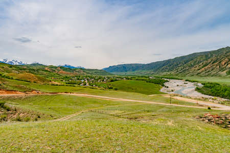 Saty Kolsai Lakes Breathtaking Picturesque Panoramic Landscape View of Town on a Cloudy Blue Sky Day