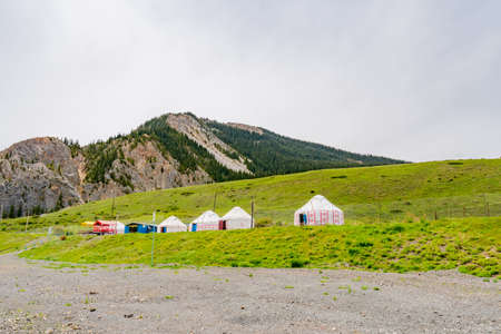 Saty Kolsai Lakes Breathtaking Picturesque Panoramic Landscape View of Yurt Camp on a Cloudy Blue Sky Day
