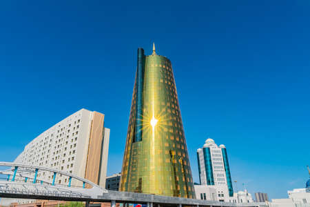 Nur-Sultan Astana House of Ministers of the Republic of Kazakhstan Golden Colored Building on a Sunny Blue Sky Day Stock fotó