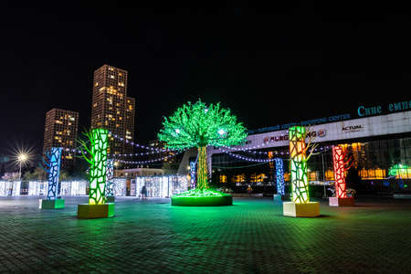Nur-Sultan Astana Saryarka Square with an Artificial Tree Decorated with Colored Light Bulbs at Night