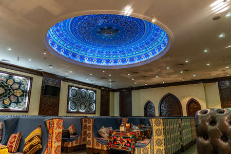 Taraz Popular Samarkand City Restaurant Picturesque Indoor View with Blue Colored Ceiling Lights Stock Photo