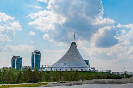 Nur-Sultan Astana Royal Marquee Khan Shatyr Entertainment Center at Background on a Sunny Cloudy Blue Sky Day