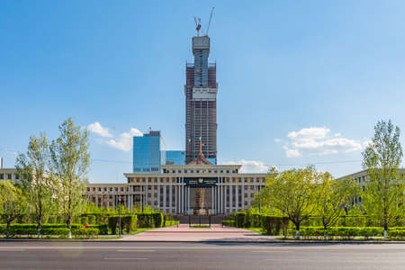 Nur-Sultan Astana Ministry of Defense of the Republic of Kazakhstan Frontal View with Building under Construction on a Sunny Cloudy Blue Sky Day Stock fotó - 133441604