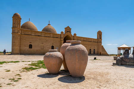 Turkestan Arystan Bab Mausoleum Breathtaking Picturesque View with Clay Pots on a Sunny Blue Sky Day