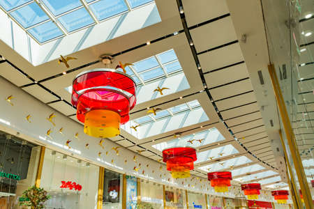 Nur-Sultan Astana Mega Silkway Shopping Mall Picturesque Ceiling Red Colored Lanterns on a Sunny Blue Sky Day Stock fotó