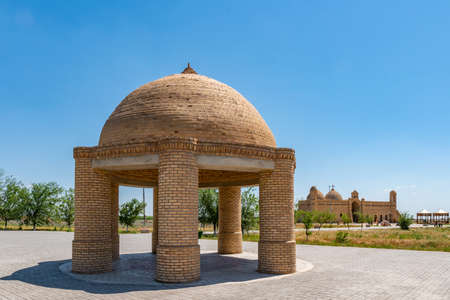 Turkestan Arystan Bab Mausoleum Pavilion with Main Tomb Building at Background on a Sunny Blue Sky Day Stock Photo