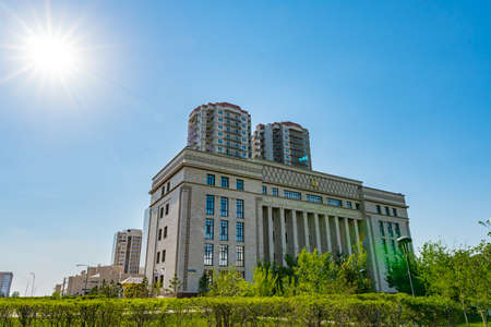 Nur-Sultan Astana Akimat of Saryarka Rayon Government Building with Picturesque Sun Rays on a Sunny Blue Sky Day