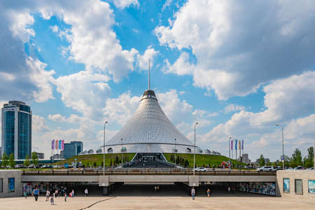 Nur-Sultan Astana Royal Marquee Khan Shatyr Entertainment Center with Walking People and Driving Cars on a Sunny Cloudy Blue Sky Day