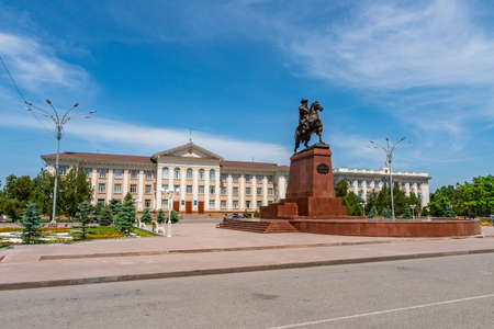 Taraz Akimat City Hall with Statue of Baydibek Batyr Riding a Horse View on a Sunny Blue Sky Day
